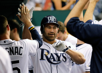 ST. PETERSBURG, FL - MAY 16:  Designated hitter Johnny Damon #22 of the Tampa Bay Rays is congratulated after his home run against the New York Yankees during the game at Tropicana Field on May 16, 2011 in St. Petersburg, Florida.  (Photo by J. Meric/Gett