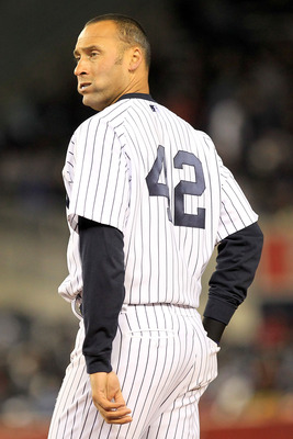 NEW YORK, NY - APRIL 15:  Derek Jeter of the New York Yankees wears the #42 jersey to commemorate Jackie Robinson Day during the game against the Texas Rangers at Yankee Stadium on April 15, 2011 in the Bronx borough of New York City.  (Photo by Chris Tro