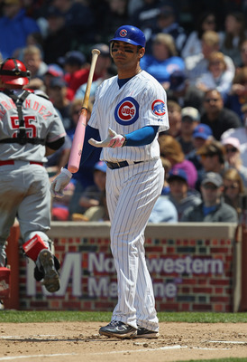 CHICAGO, IL - MAY 08: Carlos Pena #22 of the Chicago Cubs flips his bat after striking out against the Cincinnati Reds at Wrigley Field on May 8, 2011 in Chicago, Illinois. The Reds defeated the Cubs 2-0.  (Photo by Jonathan Daniel/Getty Images)
