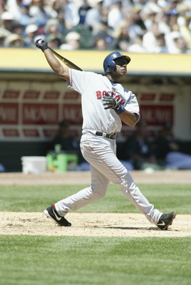 OAKLAND, CA - MAY 9:  First baseman Jose Offerman #30 of the Boston Red Sox watches the flight of his two run homerun in the third inning, (his third of the season) off  Tim Hudson of the Oakland A's during the MLB game at Network Associates Coliseum in O