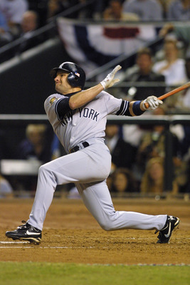 28 Oct 2001: Chuck Knoblauch #11 of the New York Yankees swings at a pitch during game 2 of the World Series against the Arizona Diamondbacks at Bank One Ballpark in Phoenix, Arizona. The Diamondbacks win, 4-0 over the Yankees. DIGITAL IMAGE Mandatory Cre