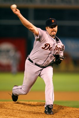 OAKLAND, CA - OCTOBER 11:  Relief pitcher Todd Jones #59 of the Detroit Tigers pitches against the Oakland Athletics in Game Two of the American League Championship Series on October 11, 2006 at McAfee Coliseum in Oakland, California. The Detroit Tigers d