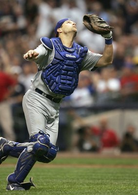 MILWAUKEE - JUNE 4: Catcher Michael Barrett #8 of the Chicago Cubs runs to make the catch against the Milwaukee Brewers at Miller Park on June 4, 2007 in Milwaukee, Wisconsin. (Photo by Jonathan Daniel/Getty Images)
