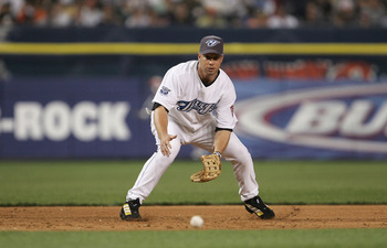 DETROIT - JULY 12:  American League All-Star Shea Hillenbrand of the Toronto Blue Jays fields an out against the National League All-Stars during the eighth inning of the 76th Major League Baseball All-Star Game on July 12, 2005 at Comerica Park in Detroi