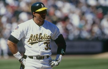 OAKLAND, CA - APRIL 3:  Jose Canseco of the Oakland Athletics looks on during the game against the Cleveland Indians at Oakland-Alameda County Coliseum on April 3, 1997 in Oakland, California. (Photo by Otto Greule Jr/Getty Images)
