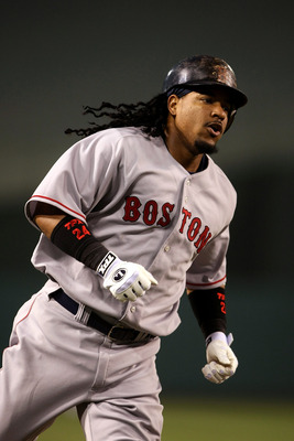 ANAHEIM, CA - JULY 18:  Manny Ramirez #24 of the Boston Red Sox runs the bases after hitting a home run in the fourth inning against the Los Angeles Angels of Anaheim on July 18, 2008 at Angel Stadium in Anaheim, California.  (Photo by Stephen Dunn/Getty