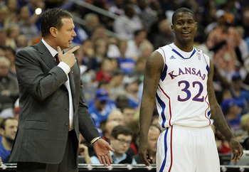 KANSAS CITY, MO - MARCH 11:  Head coach Bill Self of the Kansas Jayhawks speaks with Josh Selby #32  during their semifinal game against the Colorado Buffaloes in the 2011 Phillips 66 Big 12 Men's Basketball Tournament at Sprint Center on March 11, 2011 i