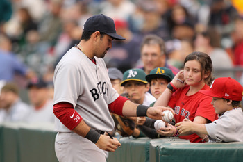 OAKLAND, CA - APRIL 19:  Adrian Gonzalez #28 of the Boston Red Sox signs autographs before their game against the Oakland Athletics at Oakland-Alameda County Coliseum on April 19, 2011 in Oakland, California.  (Photo by Ezra Shaw/Getty Images)