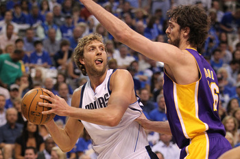 DALLAS, TX - MAY 08:  Forward Dirk Nowitzki #41 of the Dallas Mavericks looks to pass against Pau Gasol #16 of the Los Angeles Lakers in Game Four of the Western Conference Semifinals during the 2011 NBA Playoffs on May 8, 2011 at American Airlines Center