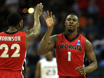 CHARLOTTE, NC - MARCH 18:  Travis Leslie #1 and Gerald Robinson #22 of the Georgia Bulldogs react in the first half while taking on the Washington Huskies during the second round of the 2011 NCAA men's basketball tournament at Time Warner Cable Arena on M