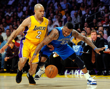 LOS ANGELES, CA - MAY 04:  DeShawn Stevenson #92 of the Dallas Mavericks boxes out Derek Fisher #2 of the Los Angeles Lakers from the ball in the first quarter in Game Two of the Western Conference Semifinals in the 2011 NBA Playoffs at Staples Center on