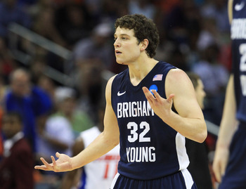 NEW ORLEANS, LA - MARCH 24:  Jimmer Fredette #32 of the Brigham Young Cougars reacts after being injured during their game against the Florida Gators in the Southeast regional of the 2011 NCAA men's basketball tournament at New Orleans Arena on March 24,