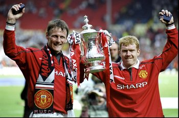 22 May 1999:  The two goal scorers Teddy Sheringham and Paul Scholes of Manchester United celebrate victory with the trophy after the AXA FA Cup Final match against Newcastle United played at Wembley Stadium in London, England.  The match finished in a 2-