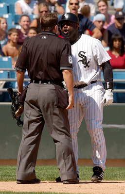 CHICAGO - AUGUST 21:  Carl Everett #8 of the Chicago White Sox argues with home plate umpire Doug Eddings #88 after striking out with the bases loaded in the sixth inning during a game against the Boston Red Sox on August 21, 2004 at U.S. Cellular Field i