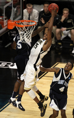 CHICAGO, IL - MARCH 18:  JaJuan Johnson #25 of the Purdue Boilermakers shoots against Jeron Belin #5 of the St. Peter's Peacocks in the second half during the second round of the 2011 NCAA men's basketball tournament at the United Center on March 18, 2011