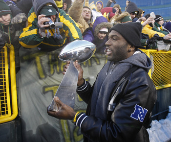 GREEN BAY, WI - FEBRUARY 08:  Green Bay Packers safety Nick Collins carries the Lombardi Trophy around Lambeau field during the Packers victory ceremony on February 8, 2011 in Green Bay, Wisconsin.  (Photo by Matt Ludtke/Getty Images)