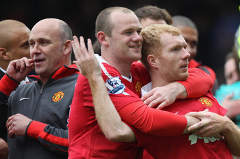 BLACKBURN, ENGLAND - MAY 14:  Wayne Rooney (L) and Paul Scholes (R) of Manchester United celebrate clinching the title during the Barclays Premier League match between Blackburn Rovers and Manchester United at Ewood Park on May 14, 2011 in Blackburn, Engl