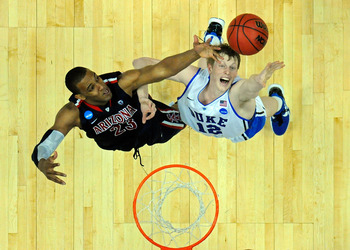 ANAHEIM, CA - MARCH 24:  Derrick Williams #23 of the Arizona Wildcats fights for a rebound against Kyle Singler #12 of the Duke Blue Devils during the west regional semifinal of the 2011 NCAA men's basketball tournament at the Honda Center on March 24, 20
