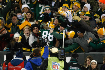 GREEN BAY, WI - DECEMBER 7:  Tight end Jermichael Finley #88 of the Green Bay Packers celebrates a touchdown by jumping in the stands with fans for a Lambeau leap in the first half against the Baltimore Ravens at Lambeau Field on December 7, 2009 in Green