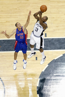 SAN ANTONIO - JUNE 9:  Glenn Robinson #3 of the San Antonio Spurs moves the ball agianst Tayshaun Prince #22 of the Detroit Pistons in Game one of the 2005 NBA Finals at SBC Center on June 9, 2005 in San Antonio, Texas.  NOTE TO USER: User expressly ackno
