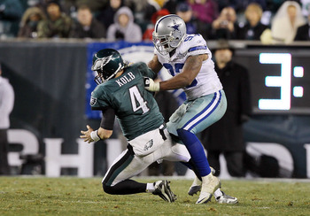 PHILADELPHIA, PA - JANUARY 02:  Kevin Kolb #4 of the Philadelphia Eagles is sacked by Anthony Spencer #93 of the Dallas Cowboys on January 2, 2011 at Lincoln Financial Field in Philadelphia, Pennsylvania. The Cowboys defeated the Eagles 14-13.  (Photo by