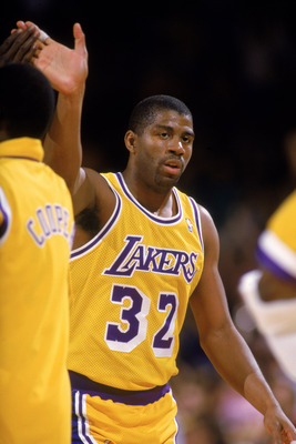 LOS ANGELES - 1987:  Magic Johnson #32 of the Los Angeles Lakers slaps hands with Michael Cooper #21 during an NBA game at the Great Western Forum in Los Angeles, California in 1987. (Photo by: Rick Stewart/Getty Images)