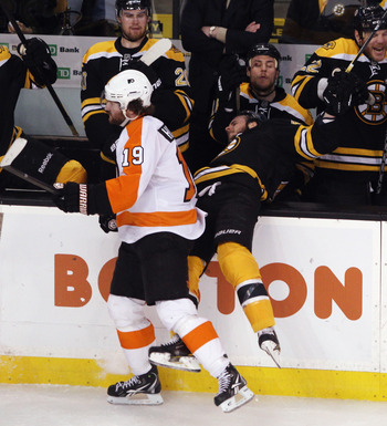 BOSTON, MA - MAY 06: Scott Hartnell #19 of the Philadelphia Flyers hits David Krejci #46 of the Boston Bruins into the boards in Game Four of the Eastern Conference Semifinals during the 2011 NHL Stanley Cup Playoffs at TD Garden on May 6, 2011 in Boston,