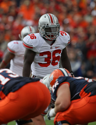 CHAMPAIGN, IL - OCTOBER 02: Brian Rolle #36 of the Ohio State Buckeyes awaits the start of play against the Illinois Fighting Illini at Memorial Stadium on October 2, 2010 in Champaign, Illinois. Ohio State defeated Illinois 24-13. (Photo by Jonathan Dani