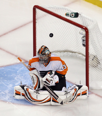 BOSTON, MA - MAY 06:  A puck bounces off the helmet of Sergei Bobrovsky #35 of the Philadelphia Flyers during his game against the Boston Bruins in Game Four of the Eastern Conference Semifinals during the 2011 NHL Stanley Cup Playoffs at TD Garden on May