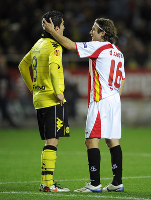 SEVILLE, SPAIN - DECEMBER 15:  Diego Capel of Sevilla (L) talks to Nuri Sahin at the end of the UEFA Europa League group J match between Sevilla and Borussia Dortmund at Estadio Ramon Sanchez Pizjuan on December 15, 2010 in Seville, Spain. The match ended