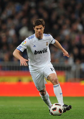 MADRID, SPAIN - MARCH 12: Xabi Alonso of Real Madrid in action during the La Liga match between Real Madrid and Hercules CF at Estadio Santiago Bernabeu on March 12, 2011 in Madrid, Spain.  (Photo by Denis Doyle/Getty Images)