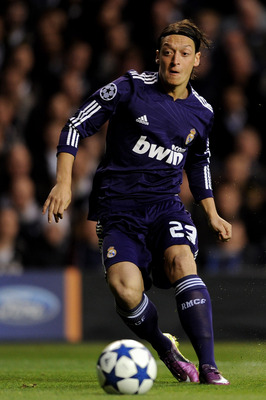 LONDON, ENGLAND - APRIL 13:  Mesut Ozil of Real Madrid in action the UEFA Champions League quarter final second leg match between Tottenham Hotspur and Real Madrid at White Hart Lane on April 13, 2011 in London, England.  (Photo by Jasper Juinen/Getty Ima