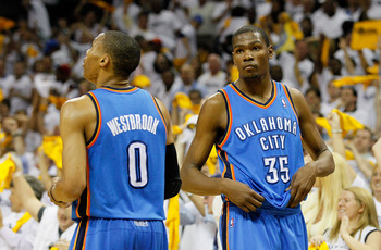 MEMPHIS, TN - MAY 13:  Russell Westbrook #0 and Kevin Durant #35 of the Oklahoma City Thunder react after their 95-83 loss to the Memphis Grizzlies in Game Six of the Western Conference Semifinals in the 2011 NBA Playoffs at FedExForum on May 13, 2011 in