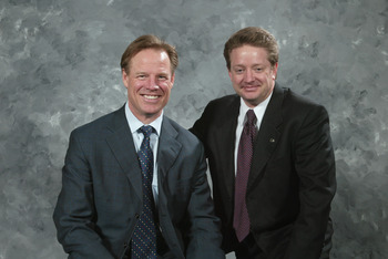 PHILADELPHIA - MARCH 2:  (L-R) Philadelphia Flyers radio broadcasters Brian Propp (color analyst) and Tim Saunders (play by play announcer) pose for a photo before the game against the New York Rangers at the Wachovia Center on March 2, 2006 in Philadelph