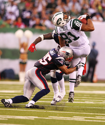 EAST RUTHERFORD, NJ - SEPTEMBER 19:  Dustin Keller #81of the New York Jets is hit by Patrick Chung #25 of the New England Patriots during their  game on September 19, 2010 at the New Meadowlands Stadium  in East Rutherford, New Jersey.  (Photo by Al Bello