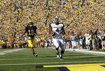 ANN ARBOR, MI - OCTOBER 09:  Edwin Baker #4 of the Michigan State Spartans scores on a 61 yard touchdown in the second quarter against the Michigan Wolverines during the game on October 9, 2010 at Michigan Stadium in Ann Arbor, Michigan. The Michigan Stat