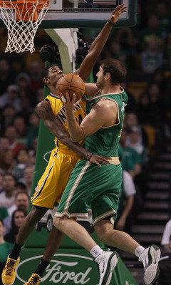 BOSTON, MA - MARCH 16:  Paul George #24 of the Indiana Pacers fouls Nenad Krstic #4 of the Boston Celtics on March 16, 2011 at the TD Garden in Boston, Massachusetts. The Celtics defeated the Indiana Pacers 92-80. NOTE TO USER: User expressly acknowledges