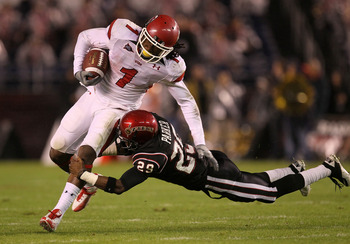 SAN DIEGO - NOVEMBER 20:  Wide receiver Shaky Smithson #1 of the Utah Utes is tackled by defensive back Larry Parker #29 of the San Diego State Aztecs at Qualcomm Stadium on November 20, 2010 in San Diego, California. Utah won 38-34.  (Photo by Stephen Du