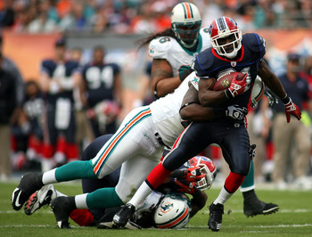 MIAMI - DECEMBER 19:  Running Back C.J. Spiller #21 of the Buffalo Bills runs against the Miami Dolphins at Sun Life Stadium on December 19, 2010 in Miami, Florida.The Bills defeated the Dolphins 17-14.  (Photo by Marc Serota/Getty Images)