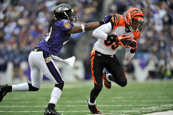BALTIMORE, MD - JANUARY 2:  Jerome Simpson #89 of the Cincinnati Bengals runs the ball against Lardarius Webb #21 of the Baltimore Ravens at M&amp;T Bank Stadium on January 2, 2011 in Baltimore, Maryland. The Ravens lead the Bengals 6-0 at the half. (Photo by