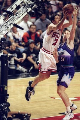 10 Jun 1998:  Tony Kukoc #7 of the Chicago Bulls in action against Adam Keefee #31 of the Utah Jazz during the NBA Finals Game 4 at the United Center in Chicago, Illinois. The Bulls defeated the Jazz 86-82. Mandatory Credit: Al Bello  /Allsport
