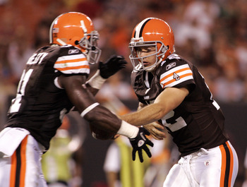CLEVELAND - SEPTEMBER 2:  Colt McCoy #12 of the Cleveland Browns hands the ball off to Montario Hardesty #31 against the Chicago Bears during the preseason game on September 2, 2010 at Cleveland Browns Stadium in Cleveland, Ohio. The Browns defeated the B