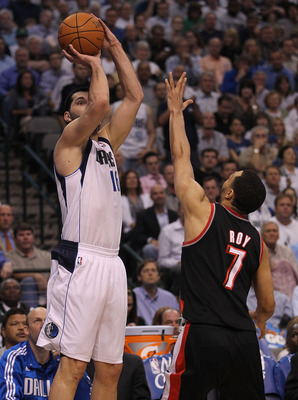 DALLAS, TX - APRIL 25:  Forward Peja Stojakovic #16 of the Dallas Mavericks takes a shot against Brandon Roy #7 of the Portland Trail Blazers in Game Five of the Western Conference Quarterfinals during the 2011 NBA Playoffs on April 25, 2011 at American A