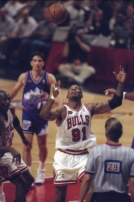10 Jun 1998:  Dennis Rodman #91 of the Chicago Bulls in action against John Stockton of the Utah Jazz during the NBA Finals Game 4 at the United Center in Chicago, Illinois.  The Bulls defeated the Jazz 86-82. Mandatory Credit: Jonathan Daniel  /Allsport
