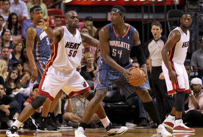MIAMI, FL - APRIL 08:  Kwame Brown #54 of the Charlotte Bobcats posts up Joel Anthony #50 of the Miami Heat during a game at American Airlines Arena on April 8, 2011 in Miami, Florida. NOTE TO USER: User expressly acknowledges and agrees that, by download