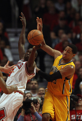 CHICAGO, IL - APRIL 26: Loul Deng #9 of the Chicago Bulls battles for a rebound with Danny Granger #33 of the Indiana Pacers in Game Five of the Eastern Conference Quarterfinals in the 2011 NBA Playoffs at the United Center on April 26, 2011 in Chicago, I