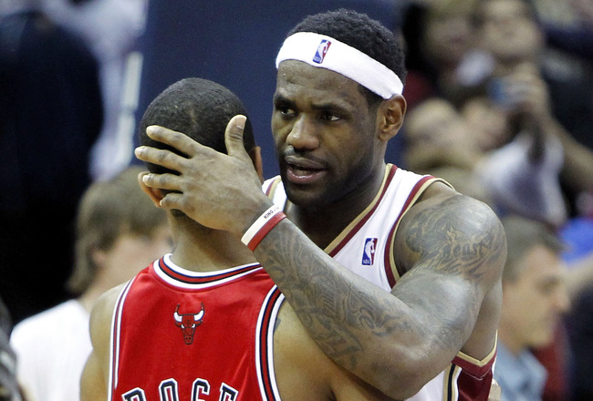 CLEVELAND - APRIL 27:  LeBron James #23 of the Cleveland Cavaliers talks with Derrick Rose #1 of the Chicago Bulls after defeating the Bulls 96-94 in Game Five of the Eastern Conference Quarterfinals during the 2010 NBA Playoffs at Quicken Loans Arena on
