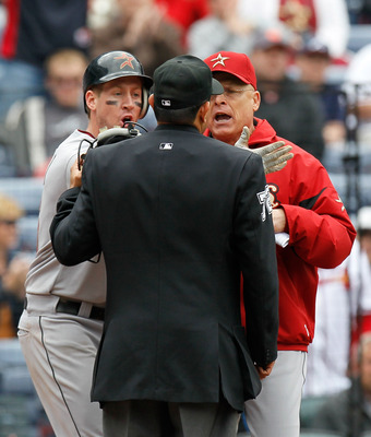 ATLANTA, GA - MAY 17:  Matt Downs #16 and manager Brad Mills of the Houston Astros argue with homeplate umpire Alfonso Marquez #72 after Downs appeared to be hit by a pitch but it was ruled a foul ball in the 11th inning against the Atlanta Braves at Turn