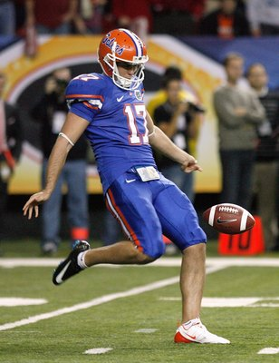 ATLANTA - DECEMBER 06:  Chas Henry #17 of the Florida Gators punts the ball against the Alabama Crimson Tide during the SEC Championship on December 6, 2008 at the Georgia Dome in Atlanta, Georgia.  (Photo by Kevin C. Cox/Getty Images)
