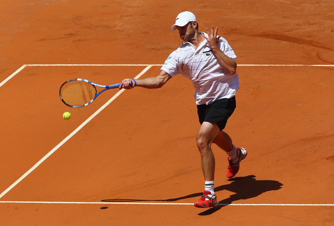 ROME, ITALY - MAY 09:  Andy Roddick of the USA plays a forehand during his first round match against Gilles Simon of France during day two of the Internazoinali BNL D'Italia at the Foro Italico Tennis Centre on May 9, 2011 in Rome, Italy.  (Photo by Clive
